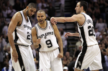 SAN ANTONIO - APRIL 23: Tony Parker #9 of the San Antonio Spurs reacts with Tim Duncan #21 and Manu Ginobili #20 against the Dallas Mavericks in Game Three of the Western Conference Quarterfinals during the 2010 NBA Playoffs at AT&T Center on April 23, 20