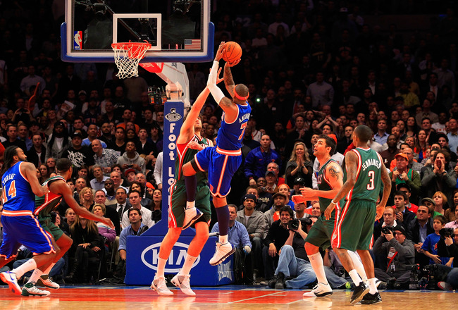 NEW YORK, NY - FEBRUARY 23:  Carmelo Anthony #7 of the New York Knicks shoots the ball over Andrew Bogut #6 of the Milwaukee Bucks at Madison Square Garden on February 23, 2011 in New York City. NOTE TO USER: User expressly acknowledges and agrees that, b