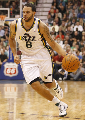 SALT LAKE CITY, UT - DECEMBER 8:  Deron Williams #8 of the Utah Jazz drives the ball down court during a game against the Miami Heat during the second half of an NBA game December 8, 2010 at Energy Solutions Arena in Salt Lake City, Utah. The Heat beat th