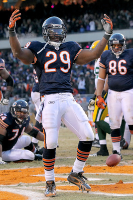 CHICAGO, IL - JANUARY 23:  Running back Chester Taylor #29 of the Chicago Bears reacts after scoring a one-yard fourth quarter touchdown against the Green Bay Packers in the NFC Championship Game at Soldier Field on January 23, 2011 in Chicago, Illinois.