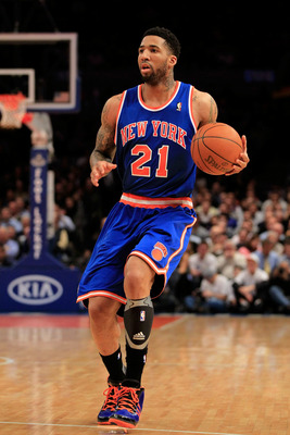 NEW YORK, NY - FEBRUARY 16: Wilson Chandler #21 of the New York Knicks dribbles the ball against the Atlanta Hawks at Madison Square Garden on February 16, 2011 in New York City. NOTE TO USER: User expressly acknowledges and agrees that, by downloading an