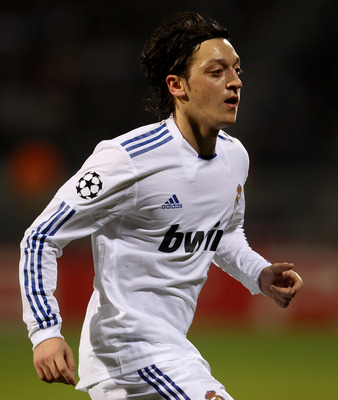 LYON, FRANCE - FEBRUARY 22:  Mesut Ozil of Real Madrid during the Champions League match between Lyon and Real Madrid at Stade Gerland on February 22, 2011 in Lyon, France.  (Photo by Scott Heavey/Getty Images)