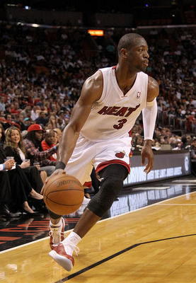 MIAMI, FL - FEBRUARY 22:  Dwyane Wade #3 of the Miami Heat dribbles around the corner during a game against the Sacramento Kings at American Airlines Arena on February 22, 2011 in Miami, Florida. NOTE TO USER: User expressly acknowledges and agrees that,