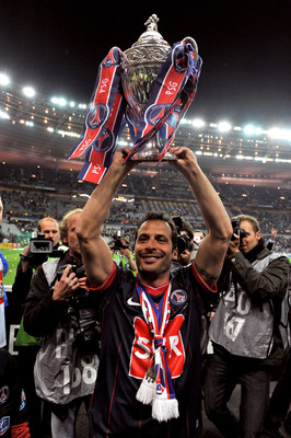 PARIS - MAY 01: Paris Saint-Germain's French Striker Ludovic Giuly holds the trophy to celebrate the winning of the French Cup final between Paris Saint Germain football club and A.S Monaco at Stade de France on May 1, 2010 in Paris, France. Paris Saint G
