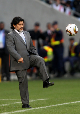 CAPE TOWN, SOUTH AFRICA - JULY 03:  Diego Maradona head coach of Argentina controls the ball on the touchline during the 2010 FIFA World Cup South Africa Quarter Final match between Argentina and Germany at Green Point Stadium on July 3, 2010 in Cape Town