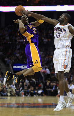 CHARLOTTE, NC - FEBRUARY 14:  Kobe Bryant #24 of the Los Angeles Lakers has the ball knocked loose by Nazr Mohammed #13 of the Charlotte Bobcats during their game at Time Warner Cable Arena on February 14, 2011 in Charlotte, North Carolina. NOTE TO USER: