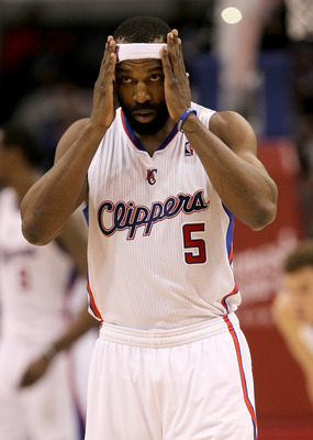LOS ANGELES, CA - DECEMBER 22:  Baron Davis #5 of the Los Angeles Clippers adjusts his head band during the game with the Houston Rockets at Staples Center on December 22, 2010 in Los Angeles, California.  The Rockets won 97-92. NOTE TO USER: User express
