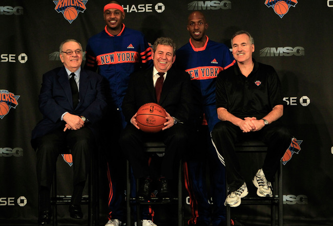 NEW YORK, NY - FEBRUARY 23:  New York Knicks owner (C) Jim Dolan, General Manager Donnie Walsh and Head Coach Mike D'Antoni introduce new players  Carmelo Anthony and Chauncy Phillips at a press conference at Madison Square Garden on February 23, 2011 in