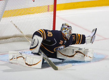 BUFFALO, NY - FEBRUARY 23: Ryan Miller #30 of the Buffalo Sabres makes a glove save against the Atlanta Thrashers at HSBC Arena on February 23, 2011 in Buffalo, New York. Buffalo won 4-1. (Photo by Rick Stewart/Getty Images)