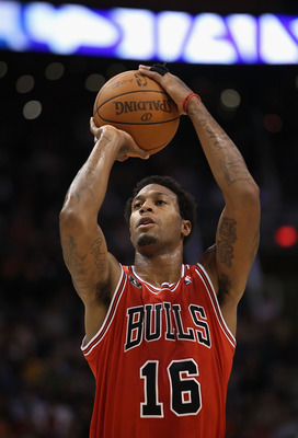 PHOENIX - NOVEMBER 24:  James Johnson #19 of the Chicago Bulls shoots a free throw shot during the NBA game against the Phoenix Suns at US Airways Center on November 24, 2010 in Phoenix, Arizona. The Bulls defeated the Suns 123-115 in double overtime. NOT