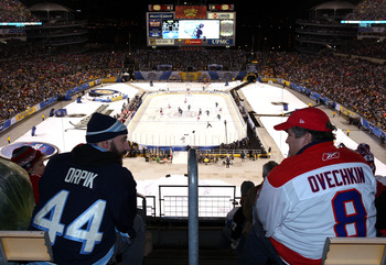 PITTSBURGH, PA - JANUARY 01:  Fans watch as the Pittsburgh Penguins take on the Washington Capitals during the 2011 NHL Bridgestone Winter Classic at Heinz Field on January 1, 2011 in Pittsburgh, Pennsylvania. Washington won 3-1.  (Photo by Jamie Squire/G
