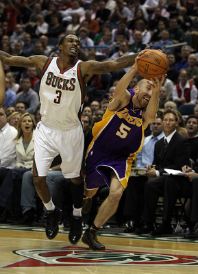 MILWAUKEE, WI - NOVEMBER 16: Brandon Jennings #3 of the Milwaukee Bucks and Steve Blake #5 of the Los Angeles Lakers battle for a loose ball at the Bradley Center on November 16, 2010 in Milwaukee, Wisconsin. The Lakers defeated the Bucks 118-107. NOTE TO
