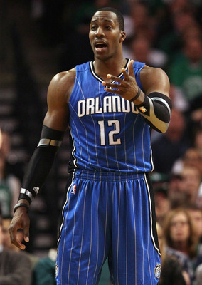 BOSTON, MA - FEBRUARY 06:  Dwight Howard #12 of the Orlando Magic reacts after he is called for a foul in the second half against the Boston Celtics on February 6, 2011 at the TD Garden in Boston, Massachusetts. The Celtics defeated the Magic 91-80. NOTE