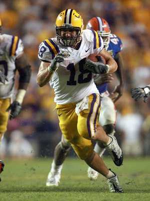 BATON ROUGE, LA - OCTOBER 06: Jacob Hester #18 of the LSU Tigers carries the ball against the Florida Gators at Tiger Stadium on October 6 , 2007 in Baton Rouge, Louisiana. LSU defeated Florida 28-24. (Photo by Doug Benc/Getty Images)