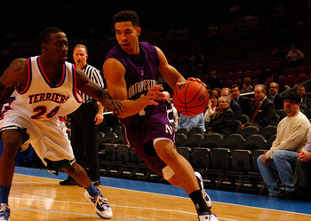 NEW YORK, NY - DECEMBER 20:  Drew Crawford #1 of the Northwestern Wildcats drives against Akeem Bennett #24 of the St. Francis Terriers during the Madison Square Garden Holiday Festival at Madison Square Garden on December 20, 2010 in New York City.  (Pho