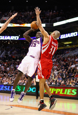 PHOENIX - JANUARY 06:  Jason Richardson #23 of the Phoenix Suns puts up a shot against Shane Battier #31 of the Houston Rockets during the NBA game at US Airways Center on January 6, 2010 in Phoenix, Arizona. The Suns defeated the Rockets 118-110.  NOTE T