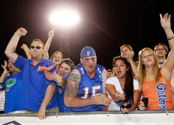 JACKSONVILLE, FL - OCTOBER 30:  Florida Gator fans celebrate following a victory against the Georgia Bulldogs at EverBank Field on October 30, 2010 in Jacksonville, Florida.  (Photo by Sam Greenwood/Getty Images)