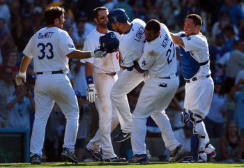 LOS ANGELES, CA - JULY 24:  (L-R) Blake DeWitt #33, Casey Blake #23, James Loney #7, Matt Kemp #27 and Russell Martin #55 of the Los Angeles Dodgers celebrate Loney's game winning walk-off homerun in the 13th inning against the New York Mets at Dodger Sta