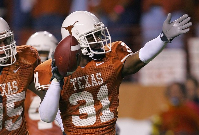 AUSTIN, TX - NOVEMBER 4:   Defensive back Aaron Ross #31 of the Texas Longhorns celebrates after intercepting a pass on the Oklahoma State Cowboys nine yard line, setting up a Texas touchdown, on November 4, 2006 at Texas Memorial Stadium in Austin, Texas