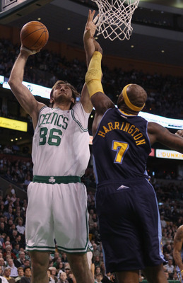 BOSTON, MA - DECEMBER 08:  Semih Erden #86 of the Boston Celtics tries to shoot around Al Harrington #7 of the Denver Nuggets on December 8, 2010 at the TD Garden in Boston, Massachusetts. NOTE TO USER: User expressly acknowledges and agrees that, by down
