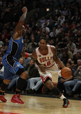 CHICAGO, IL - DECEMBER 01: James Johnson #16 of the Chicago Bulls drives around Jameer Nelson #14 of the Orlando Magic at the United Center on December 1, 2010 in Chicago, Illinois. The Magic defeated the Bulls 107-78. NOTE TO USER: User expressly acknowl