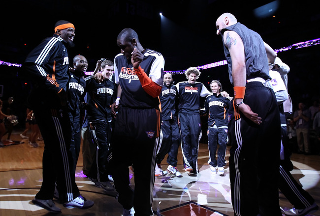 PHOENIX, AZ - FEBRUARY 17:   Mickael Pietrus #12 of the Phoenix Suns moonwalks into the huddle with teammates before the NBA game against the Dallas Mavericks at US Airways Center on February 17, 2011 in Phoenix, Arizona.  The Mavericks defeated the Suns