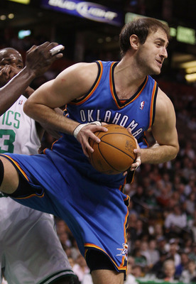 BOSTON - MARCH 31:  Nenad Krstic #12 of the Oklahoma City Thunder grabs the rebound in the first quarter against the Boston Celtics on March 31, 2010 at the TD Garden in Boston, Massachusetts.  NOTE TO USER: User expressly acknowledges and agrees that, by