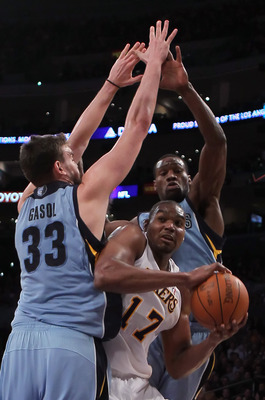 LOS ANGELES, CA - JANUARY 02:  Andrew Bynum #17 of the Los Angeles Lakers is defended by Marc Gasol (L) #33 and Tony Allen #9 of the Memphis Grizzlies during the second half at Staples Center on January 2, 2011 in Los Angeles, California. The Grizzlies de