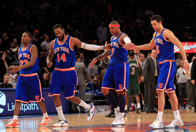 NEW YORK, NY - FEBRUARY 23:  Toney Douglas #23, Ronny Turiaf #14, Carmelo Anthony #7 and Landry Fields #6 of the New York Knicks leave the court for a timeout against the Milwaukee Bucks at Madison Square Garden on February 23, 2011 in New York City. NOTE