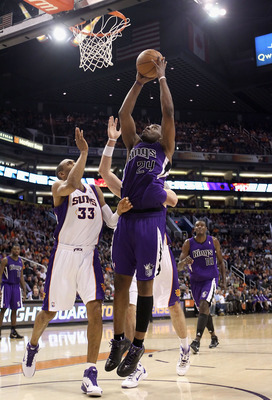 PHOENIX, AZ - FEBRUARY 13:  Carl Landry #24 of the Sacramento Kings puts up a shot over Grant Hill #33 of the Phoenix Suns during the NBA game at US Airways Center on February 13, 2011 in Phoenix, Arizona. The Kings defeated the Suns 113-108. NOTE TO USER