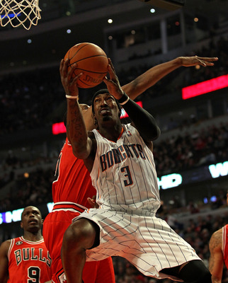 CHICAGO, IL - FEBRUARY 15: Gerald Wallace #3 of the Charlotte Bobcats goes up for a shot past Kurt Thomas #40 of the Chicago Bulls at the United Center on February 15, 2011 in Chicago, Illinois. NOTE TO USER: User expressly acknowledges and agrees that, b