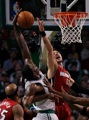 BOSTON - FEBRUARY 13:  Dexter Pittman #13 of the Miami Heat defends against Kendrick Perkins #43 of the Boston Celtics at TD Garden on February 13, 2011 in Boston, Massachusetts. NOTE TO USER: User expressly acknowledges and agrees that, by downloading an