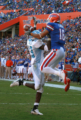 GAINESVILLE, FL - NOVEMBER 22:  Carl Moore #16 of the Florida Gators catches a pass against Cortez Allen #13 of the Citadel Bulldogs during the game at Ben Hill Griffin Stadium on November 22, 2008 in Gainesville, Florida.  (Photo by Sam Greenwood/Getty I