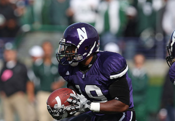 EVANSTON, IL - OCTOBER 23: Arby Fields #19 of the Northwestern Wildcats looks for running room against the Michigan State Spartans at Ryan Field on October 23, 2010 in Evanston, Illinois. Michigan State defeated Northwestern 35-27. (Photo by Jonathan Dani