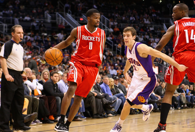 PHOENIX - JANUARY 06:  Aaron Brooks #1 of the Houston Rockets drives the ball past Goran Dragic #2 of the Phoenix Suns during the NBA game at US Airways Center on January 6, 2010 in Phoenix, Arizona. NOTE TO USER: User expressly acknowledges and agrees th