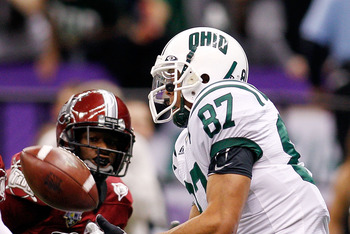 NEW ORLEANS, LA - DECEMBER 18:  Steven Goulet #87 of the Ohio University Bobcats catches a touchdown pass over Ladarrius Madden #30 of the Troy University Trojans during the R&L Carriers New Orleans Bowl at the Louisiana Superdome on December 18, 2010 in