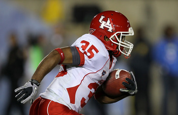 PASADENA, CA - SEPTEMBER 18:  Wide receiver Tyron Carrier  #35 of the Houston Cougars carries the ball against the UCLA Bruins at the Rose Bowl on September 18, 2010 in Pasadena, California.  UCLA won 31-13.  (Photo by Stephen Dunn/Getty Images)