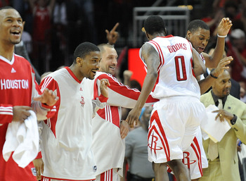 HOUSTON - MAY 10:  Guard Aaron Brooks #0 of the Houston Rockets celebrates after making a three-point shot against the Los Angeles Lakers in Game Four of the Western Conference Semifinals during the 2009 NBA Playoffs at Toyota Center on May 10, 2009 in Ho