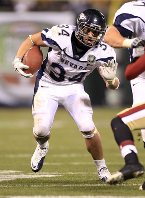 SAN FRANCISCO, CA - JANUARY 09:  Vai Taua #34 of the Nevada Wolf Pack runs with the ball against Boston College in the Kraft Fight Hunger Bowl at AT&T Park on January 9, 2011 in San Francisco, California.  (Photo by Ezra Shaw/Getty Images)