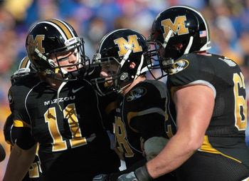 KANSAS CITY, MO - NOVEMBER 27:  Quarterback Blaine Gabbert #11 of the Missouri Tigers congratulates receiver T.J. Moe #28 after a touchdown during the game against the Kansas Jayhawks on November 27, 2010 at Arrowhead Stadium in Kansas City, Missouri.  (P