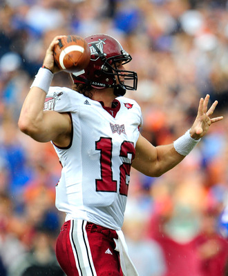 GAINESVILLE, FL - SEPTEMBER 12:  Levi Brown #12 of the Troy Trojans attempts a pass during the game against the Florida Gators at Ben Hill Griffin Stadium on September 12, 2009 in Gainesville, Florida.  (Photo by Sam Greenwood/Getty Images)