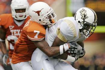 AUSTIN, TX - NOVEMBER 07:  Cornerback Deon Beasley #7 of the Texas Longhorns stops wide receiver Kamar Aiken #81 of the UCF Knights on November 7, 2009 at Darrell K Royal - Texas Memorial Stadium in Austin, Texas.  Texas won 35-3.  (Photo by Brian Bahr/Ge