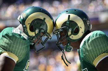 DENVER - SEPTEMBER 04:  (L-R) Elijah-Blu Smith #22 and Ivory Herd #35 of the Colorado State Rams prepare to face the Colorado Buffaloes during the the Rocky Mountain Showdown at INVESCO Field at Mile High on September 4, 2010 in Denver, Colorado. Colorado