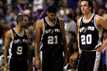 AUBURN HILLS, MI - JUNE 19:  (L-R) Tony Parker #9, Tim Duncan #21 and Manu Ginobili #20 of the San Antonio Spurs wait for the start of overtime against the Detroit Pistons in Game five of the 2005 NBA Finals at The Palace of Auburn Hills on June 19, 2005