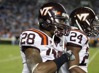 CHAPEL HILL, NC - NOVEMBER 13:  Alonzo Tweedy #28 of the Virginia Tech Hokies celebrates with teammates after recovering a fumble against the North Carolina Tar Heels during their game at Kenan Stadium on November 13, 2010 in Chapel Hill, North Carolina.