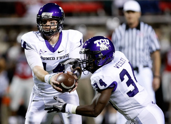 LAS VEGAS - OCTOBER 30:  Quarterback Andy Dalton #14 of the Texas Christian University Horned Frogs hands the ball off to Ed Wesley #34 during their game against the UNLV Rebels at Sam Boyd Stadium October 30, 2010 in Las Vegas, Nevada. TCU won 48-6.  (Ph