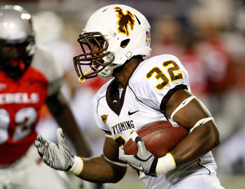 LAS VEGAS - NOVEMBER 13:  Alvester Alexander #32 of the Wyoming Cowboys runs for a 72-yard touchdown against the UNLV Rebels during their game at Sam Boyd Stadium November 13, 2010 in Las Vegas, Nevada.  (Photo by Ethan Miller/Getty Images)