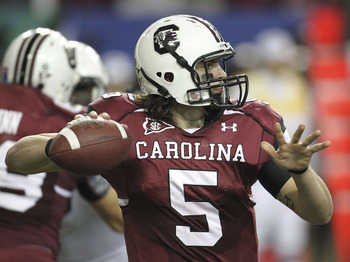 ATLANTA - DECEMBER 04:  Quarterback Stephen Garcia #5 of the South Carolina Gamecocks throws a pass during the 2010 SEC Championship against the Auburn Tigers at Georgia Dome on December 4, 2010 in Atlanta, Georgia.  (Photo by Mike Zarrilli/Getty Images)