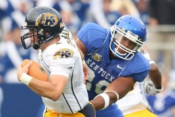 LEXINGTON, KY - SEPTEMBER 08:  Julian Edelman #1 of the Kent State Golden Flashes is presssured by Dominic Lewis #20 of the Kentucky Wildcats on September 8, 2007 at Commonwealth Stadium in Lexington, Kentucky.  (Photo by Andy Lyons/Getty Images)