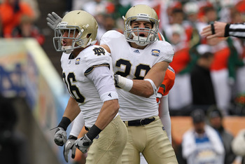 EL PASO, TX - DECEMBER 30:  (L-R) Bennett Jackson #86 and Austin Collinsworth #28 of the Notre Dame Fighting Irish celebrate a tackle against the Miami Hurricanes at Sun Bowl on December 30, 2010 in El Paso, Texas.  (Photo by Ronald Martinez/Getty Images)